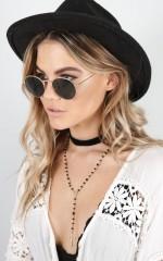 Retrograde sunglasses in rose gold and black