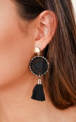 What It Feels Like earrings in black and gold