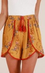 The World Can Wait shorts in mustard floral