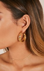 Tidal Wave earrings in gold