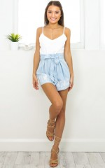 Tied Down playsuit in light blue embroidery