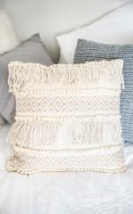 Resist It cushion in beige