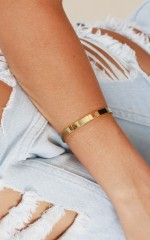 Revenge Is Sweet bangle in gold